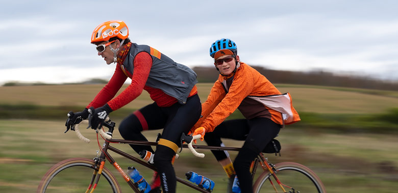 Photo of cyclists on a tandem bicycle